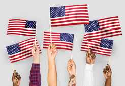close up photo of people holding usa flaglets